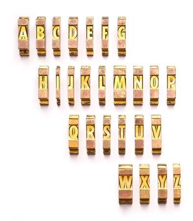 The English alphabet done in gold letterpressludlow type.