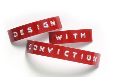 Design with Conviction done in old-fashioned punch-style lettering Stock Photo