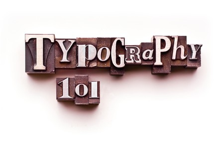 The words Typography 101 done in letterpress type