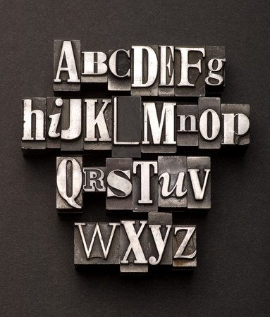 abc's: Alphabet photographed using a mix of vintage letterpress characters on a black, textured background.