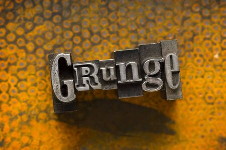 The word Grunge photographed using a mix of vintage letterpress characters. Stock Photo