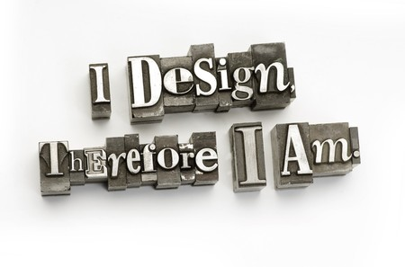 letterpress  type: The phrase I design therefore I am photographed using vintage letterpress type.