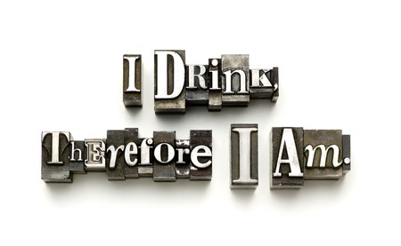 The phrase I drink therefore I am photographed using vintage letterpress type. Stock Photo