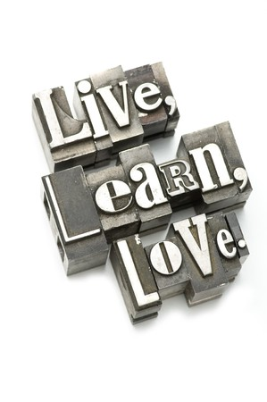 The phrase Live, Learn, Love photographed using vintage letterpress type with shallow focus. Stock Photo - 4137577
