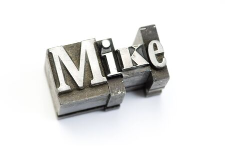 The name Mike photographed using vintage letterpress type. Stock Photo