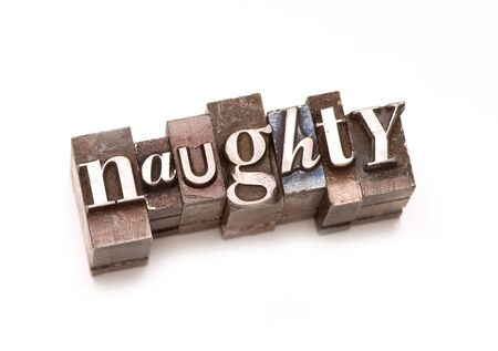 immoral: The word Naughty photographed using vintage letterpress type.
