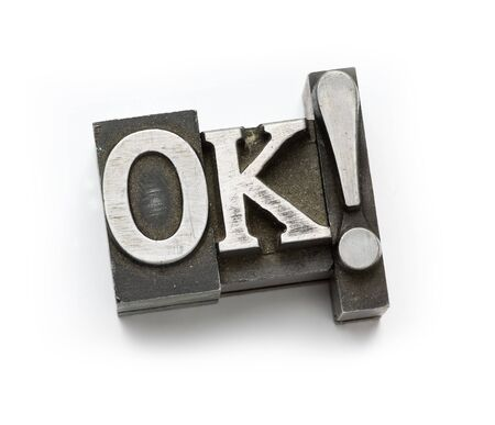 The word OK photographed using vintage letterpress type. Stock Photo