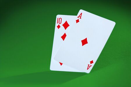 An Ace and a Ten card make Blackjack on green felt