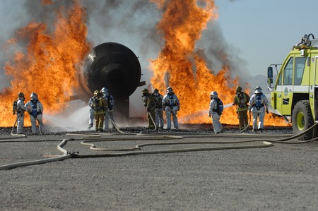 Firefighters train for battling an aircraft fire 스톡 콘텐츠