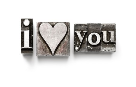 corazones: I Love You photographed using vintage letterpress type