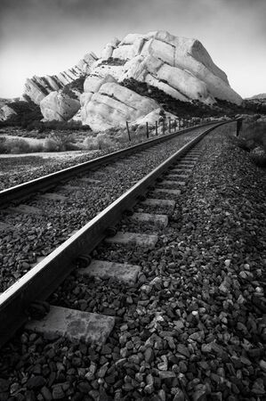 Black & White shot of railroad tracks passing by Mormon Rocks, Cajon Pass, CA