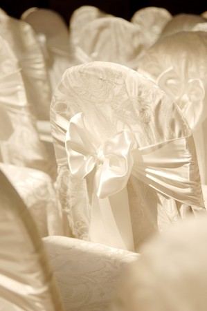 Photo of a wedding chair cover, shallow focus.