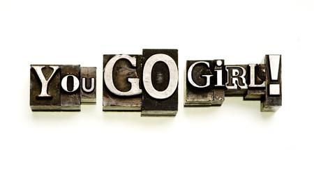 letterpress type: You Go Girl! done in letterpress type on white.