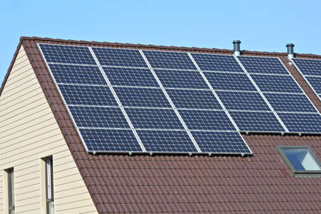 Solar panels on the roof of a house photo