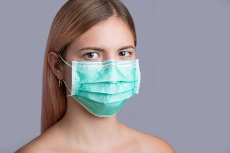 Female physician wearing medical mask