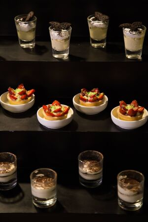 Selection of delicious desserts on a buffet table at a catered luxury event or celebration