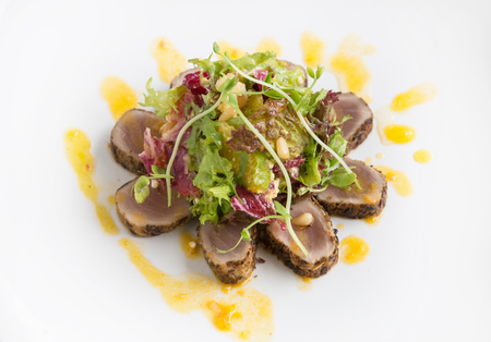 Crusted tuna with orange sauce. Delicious high end culinary Stock Photo
