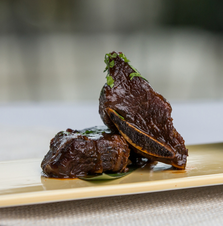 Tender delicious short beef ribs with sauce on side Archivio Fotografico