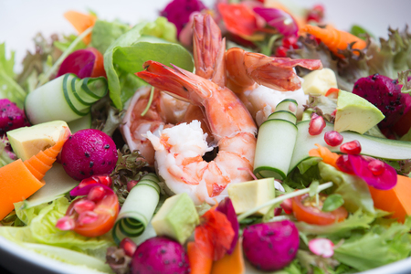 Fresh tasty salad plate with shrimp, tomato and mixed greens. Healthy food. Clean eating. Stock Photo