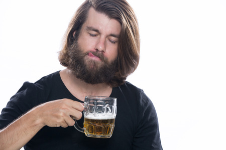 Man with a glass of beer isolated on white background, alcohol, harm