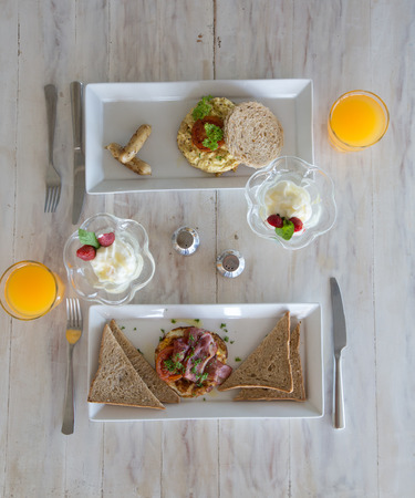 Eggs for breakfast. Healthy Breakfast with Wholemeal Bread Toast and Eggs with jam and yogurt. Top view Reklamní fotografie