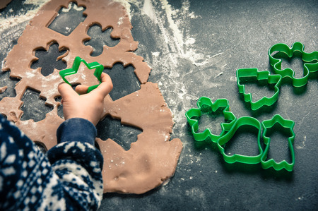 Mother and child making Christmas cookies and having fun. Christmas and New Year concept