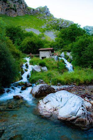 Asturias, Spain, June 22, 2020: watermill in an small river waterfall