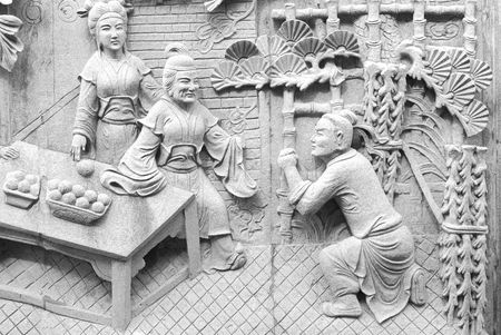 Chinese fable about filial piety by stone carving in temple. Stock Photo