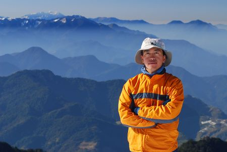mountaineer portrait with beautiful mountain scenery. photo