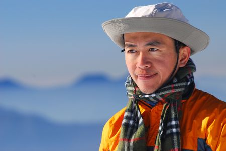 mountaineer portrait with beautiful mountain scenery. photo