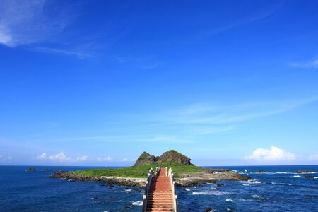 small green island and beautiful seascape in pacific ocean coastline. photo