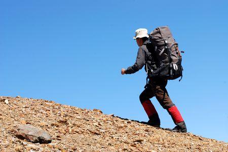 asian climber walks on the macadam slope. Stock Photo