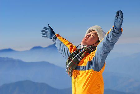 asian climber enjoy sunshine with beautiful mountain scenery. Stock Photo