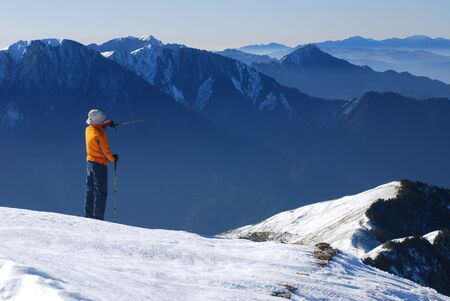 mountaineer  guide stand on snow mountain photo