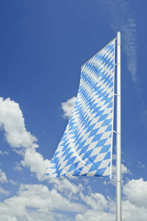 bavarian culture: Bavarian flag with blue sky in Germany.