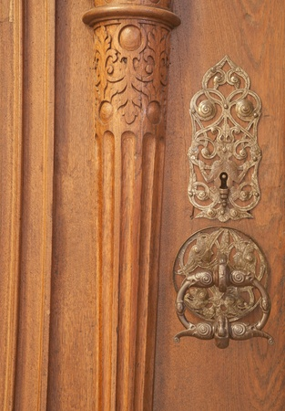 Ancient image of old door knocker on a wooden door in Europe. Stock Photo - 10629074