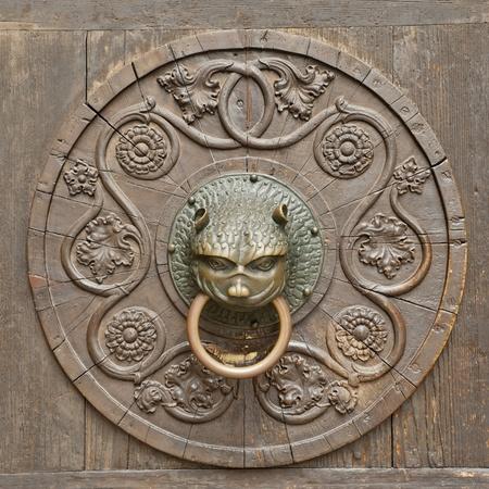 Grunge medieval background - rusty antique door knocker Stock Photo