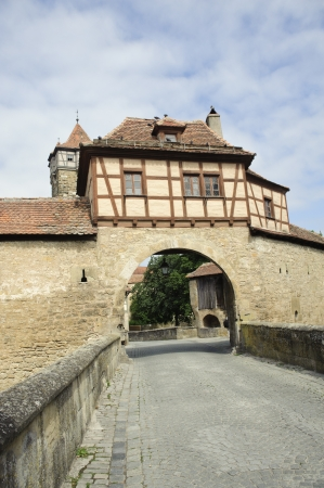 City views of ancient stone door in Rothenburg ,germany  photo