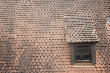 antique window on roof in Germany. photo
