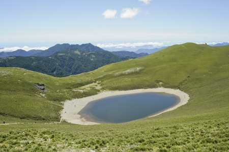 green hiking trail with beautiful lake scenery in yushan national park.