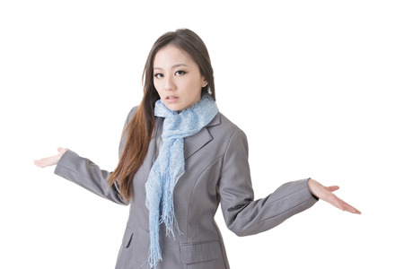 shrugs: Helpless young business woman shrugs her shoulders on white background