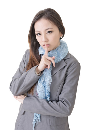 Happy businesswoman with silent gesture, closeup up portrait of oriental office lady  photo