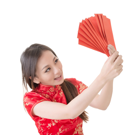 qipao: Attractive Chinese woman dress traditional cheongsam and hold red envelope, closeup portrait on white background  Stock Photo