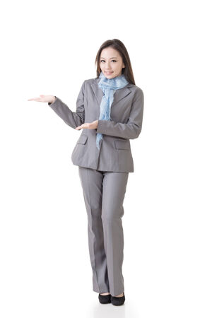 Asian business woman showing and introducing, full length portrait isolated on white background  photo