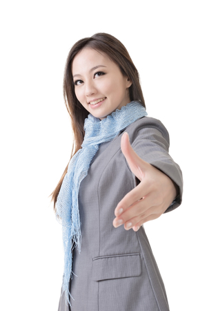 Young business woman shake hand with you, closeup portrait isolated on white background  photo
