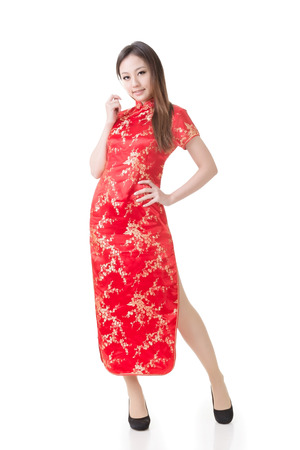 qipao: Chinese woman dress traditional cheongsam at New Year, studio shot isolated on white background