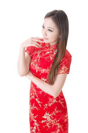 qipao: Smiling Chinese woman dress traditional cheongsam at New Year, studio shot isolated on white background  Stock Photo