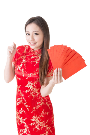 Attractive Chinese woman dress traditional cheongsam and hold red envelope, closeup portrait on white background  photo