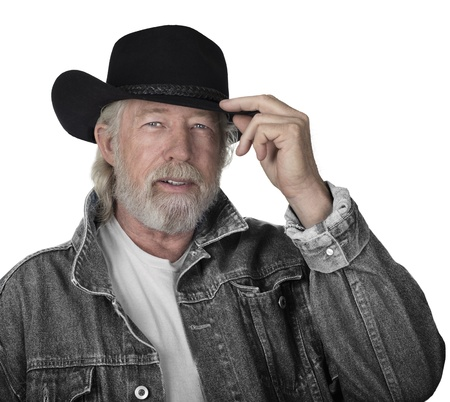 a year older: Handsome mature man wearing a gray jeans jacket and black felt cowboy hat with blue eyes Stock Photo