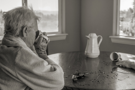 A senior woman calmly drinking coffee after murdering her partner after having endured years of abuse photo